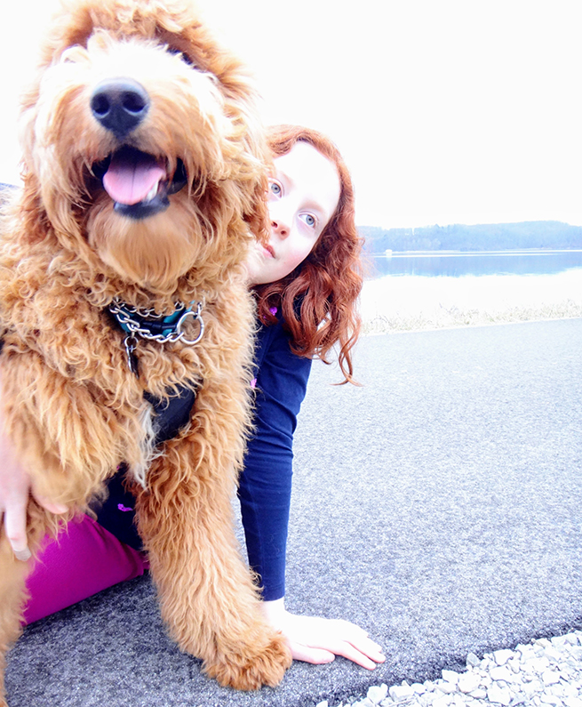 image red head girl and goldendoodle