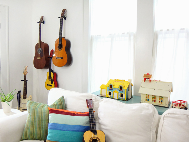 picture family room guitars and toys